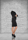 Headless businesswoman in office on the brick wall background Stock Photo