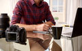 Headless crop of a photographer at his home workspace Royalty Free Stock Photo