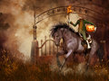 Headless horseman fantasy scenery with a cemetery gate and Royalty Free Stock Image
