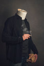 Headless man with ashtray and skull smoking a cigarette full Royalty Free Stock Photos