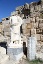 Headless statue near stone wall in salamis north cyprus Royalty Free Stock Photo