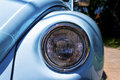 Headlight close up of the of a vintage light blue volkswagen beetle Stock Image
