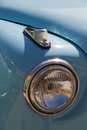 Headlight and flashing signal of classic car headlamp front light in blue Stock Photo