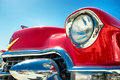 Headlight of a oldtimer in front blue sky Royalty Free Stock Photography