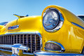 Headlight of a oldtimer in front blue sky Stock Photos