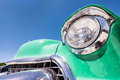 Headlight of a oldtimer in front blue sky Stock Image