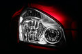 Headlight of red car close up Stock Images