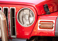 Headlight of red suv closeup photo Royalty Free Stock Images