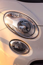 Headlights of a shiny car in sunset light Royalty Free Stock Photos