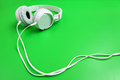 Headphone on green background the Stock Photography