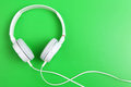 Headphone on green background music instrument Royalty Free Stock Photo