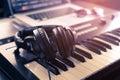Headphone on home Music studio keyboard Royalty Free Stock Photo