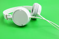 Headphone over green background close up Stock Images