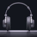 Headphone text center with reflection in desk your in the Stock Images