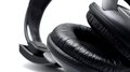 Headphones black on the white background closeup shot Stock Photo