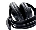 Headphones black on the white background closeup shot Stock Images