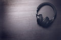 Headphones on a dark background. Music accessories. Bluetooth headphones without cable. Royalty Free Stock Photo