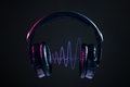 Headphones and disco waves isolated on black background Royalty Free Stock Photo