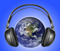 Headphones on earth Royalty Free Stock Photo