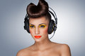 The headphones fashion a lovely photo of beautiful girl holding in her hand Royalty Free Stock Photos
