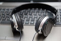 Headphones on laptop keyboard Royalty Free Stock Photo
