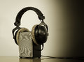 Headphones  loudspeaker  white background Royalty Free Stock Photo