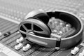 Headphones lying on the mixing console Royalty Free Stock Photo