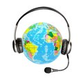Headphones with a microphone and a globe Royalty Free Stock Photo