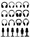 Headphones and microphones black silhouettes of Royalty Free Stock Images