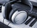 Headphones modern on a keyboard Royalty Free Stock Photos