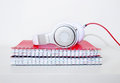 Headphones and Spiral notebook on the desktop