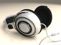 Headphones white left low dof isolated on with slight and reflective surface includes plug Royalty Free Stock Image