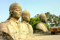 Heads of state huge statues saddam hussein stand in a deserted lot on a us military base after they were removed from the Royalty Free Stock Image