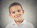 Headshot happy boy child closeup portrait smiling in white shirt isolated grey wall background positive human facial expressions Stock Photos