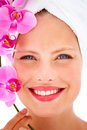 Headshot of a happy young woman holding orchid Royalty Free Stock Images