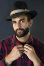 Headshot of a man with beard and hat wearing red squared shirt Royalty Free Stock Photos
