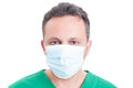 Headshot or portrait of a man doctor wearing surgeon mask Royalty Free Stock Photo