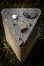 Headstone in the cemetery of the jewish ghetto at the top is the star of david and laid pebbles from visitors to the cemetery Royalty Free Stock Photography