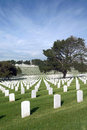 Headstones at united states national cemetery and flags american military Royalty Free Stock Images