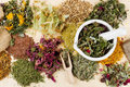 Healing herbs on wooden table, herbal medicine Royalty Free Stock Photo