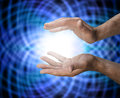 Healing matrix male healers hands with a blue energy background Stock Photos