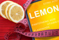 Health benefits of lemon tablet with word and measuring tape Stock Image