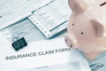 Health care billing patient medical bills and insurance claim form with piggy bank Stock Photos