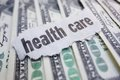 Health care cash closeup of newspaper headline on Royalty Free Stock Photos