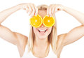 Health care conceptual portrait happy laughing girl funny holding oranges over eyes image of healthy eating dieting skincare Royalty Free Stock Images