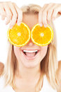 Health care conceptual portrait happy laughing girl funny holding oranges over eyes image of healthy eating dieting skincare Royalty Free Stock Photography