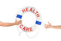 Health care life buoy ring help reaching hands an arm is out with a to the people that need and who are out for Royalty Free Stock Photos