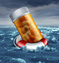Health care plan risk concept with a prescription pill bottle in a life belt or lifesaver floating in the ocean during a storm as Stock Photos