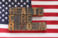 Health care reform in wood type on flag the words a usa Royalty Free Stock Images