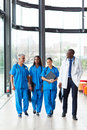 Health care workers walking group of professional in hospital Royalty Free Stock Image